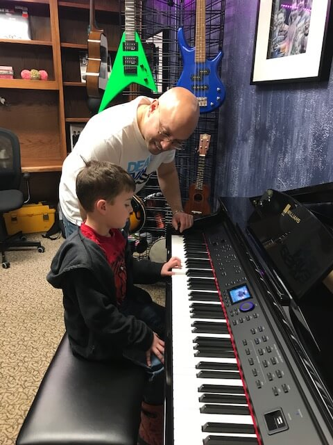 Teacher Dan teaches piano at the Community House